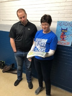 Even Mrs. Rife. is buddy reading with Mr. Hunt.